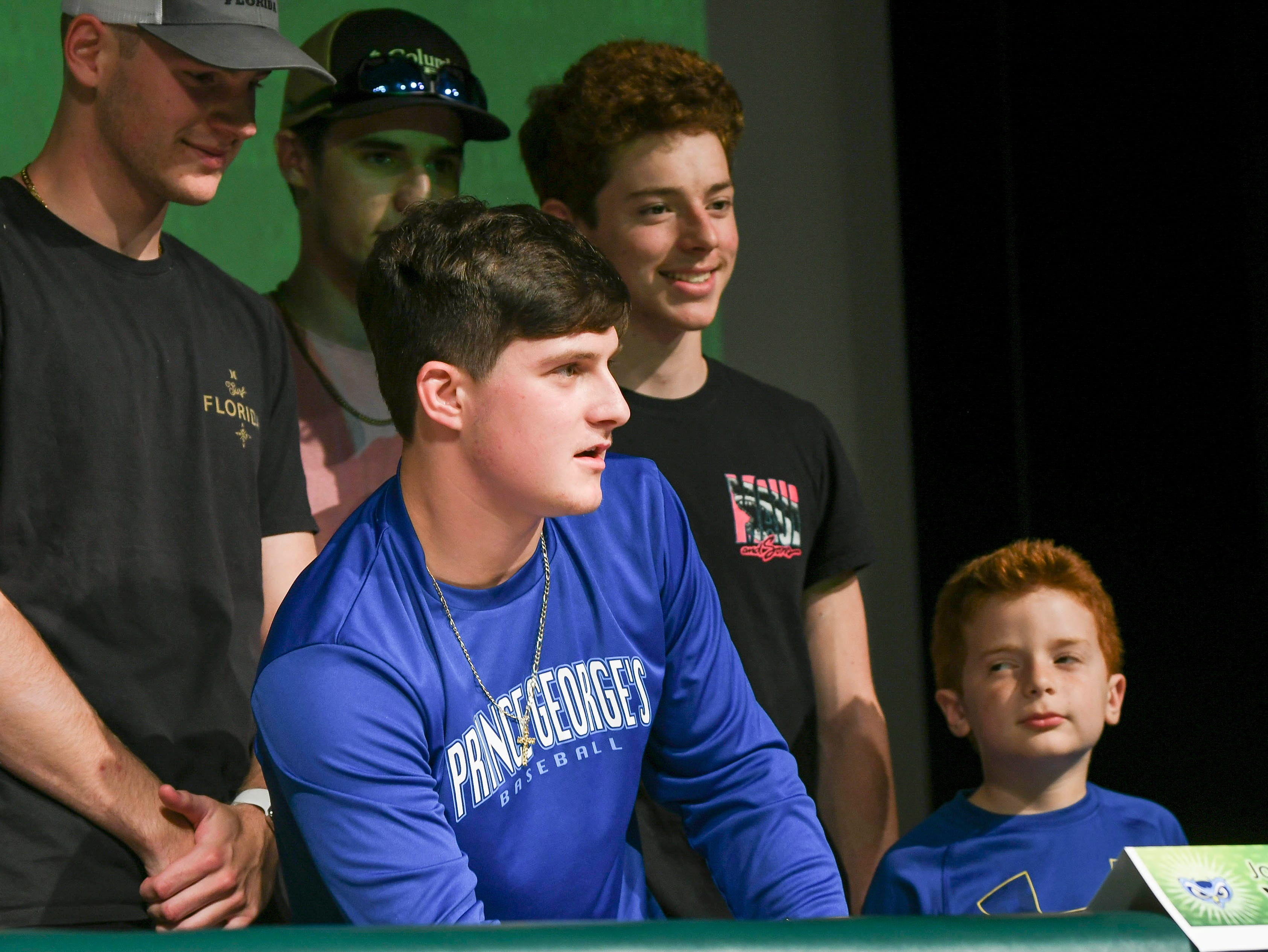 Viera High students Joe Veltri poses for pictures with his family after signing his letter of intent Wednesday during National Signing Day at the school.