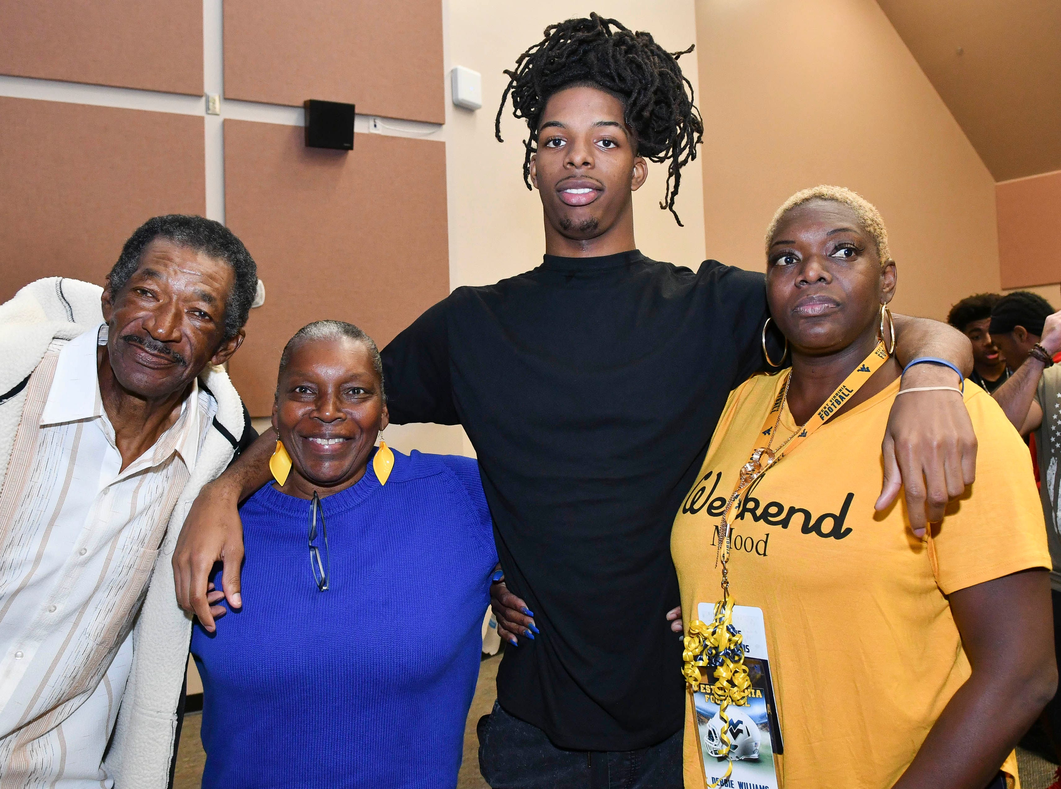 Rashean Lynn of Cocoa poses for pictures with his family during National Signing Day at Cocoa High School