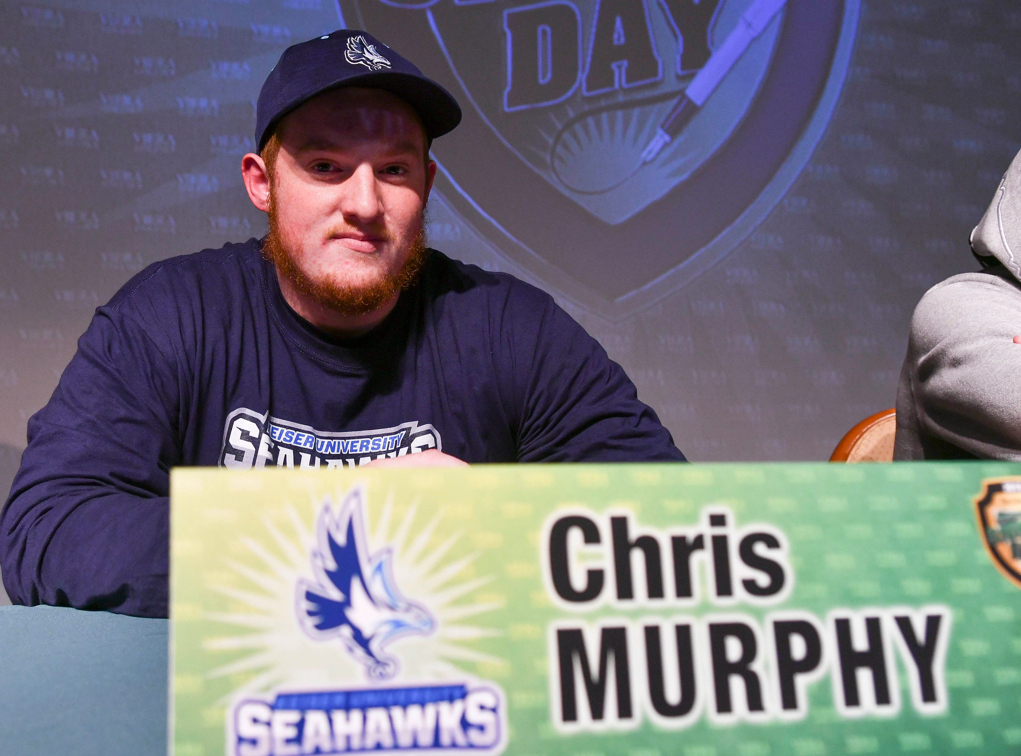 Viera High senior Chris Murphy signs his letter of intent Wednesday during National Signing Day at the school.