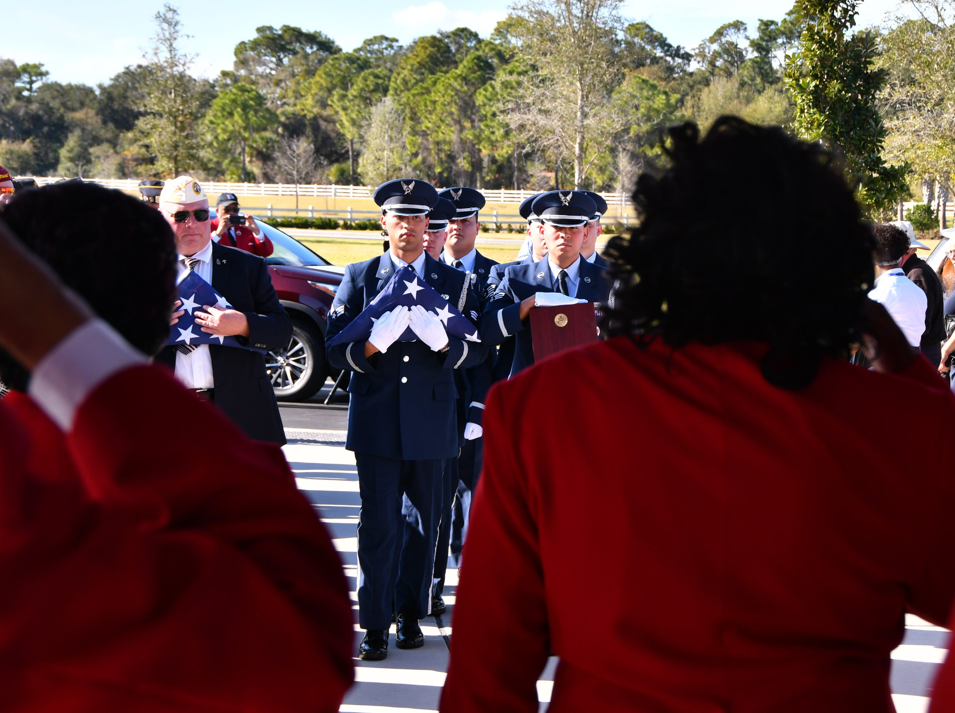 "Members of Patrick Air Force Base Honor Guard carry the  folded flags and urns from the caisson. A reburial ceremony was held at the Cape Canaveral National Cemetery Thursday afternoon for Flight Officer Edwin ""Eddie"" Cowan and his wife Theda with full military honors."