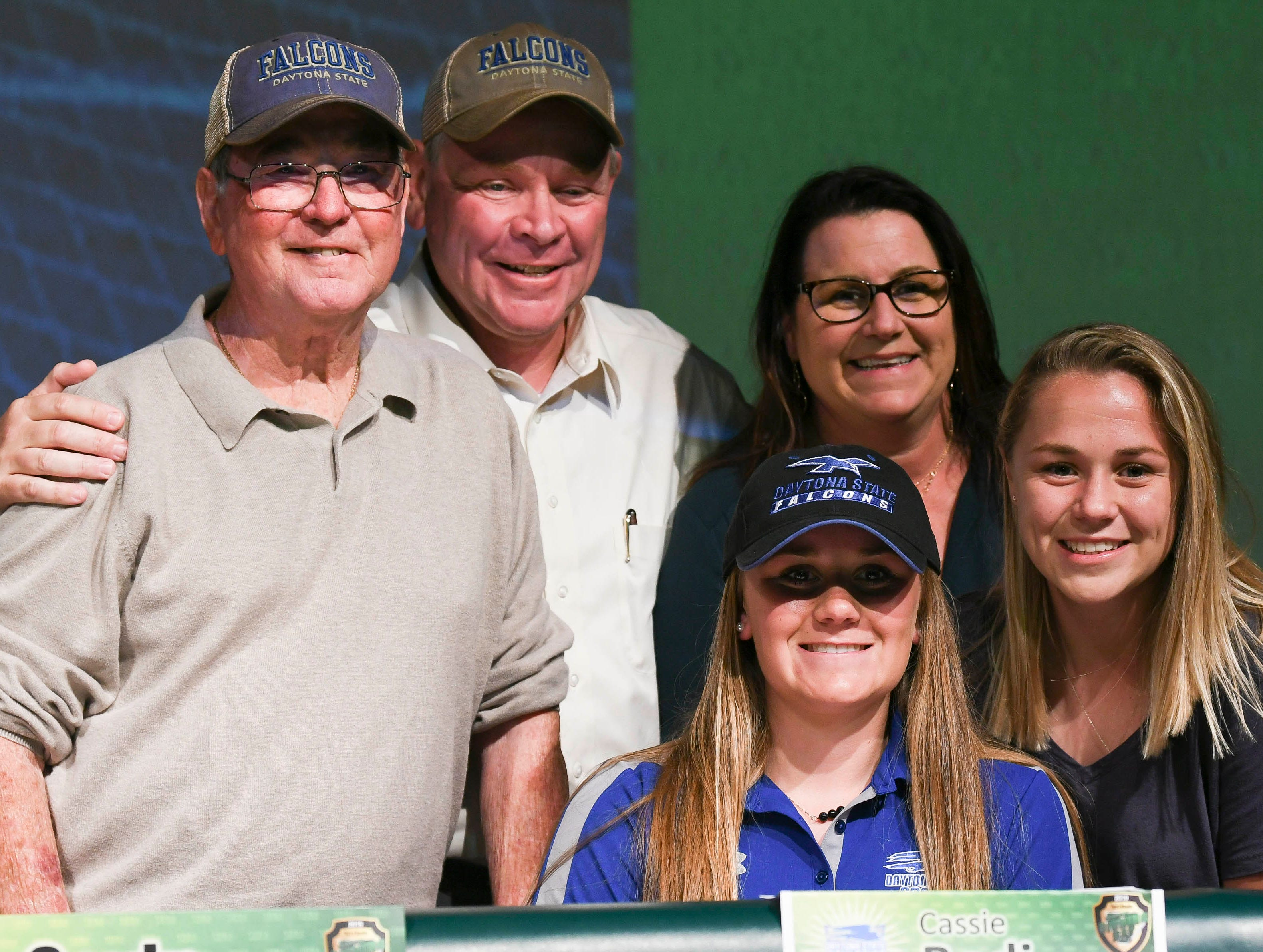 Viera High Cassie Body poses for pictures with her family after signing her letter of intent Wednesday on National Signing Day at the school.