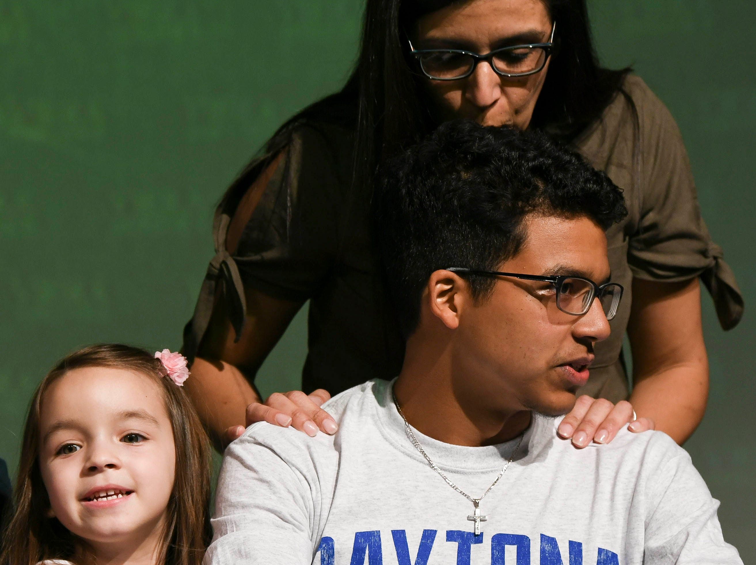 Viera High senior Andy Martinez receives a kiss after signing his letter of intent Wednesday on National Signing Day.