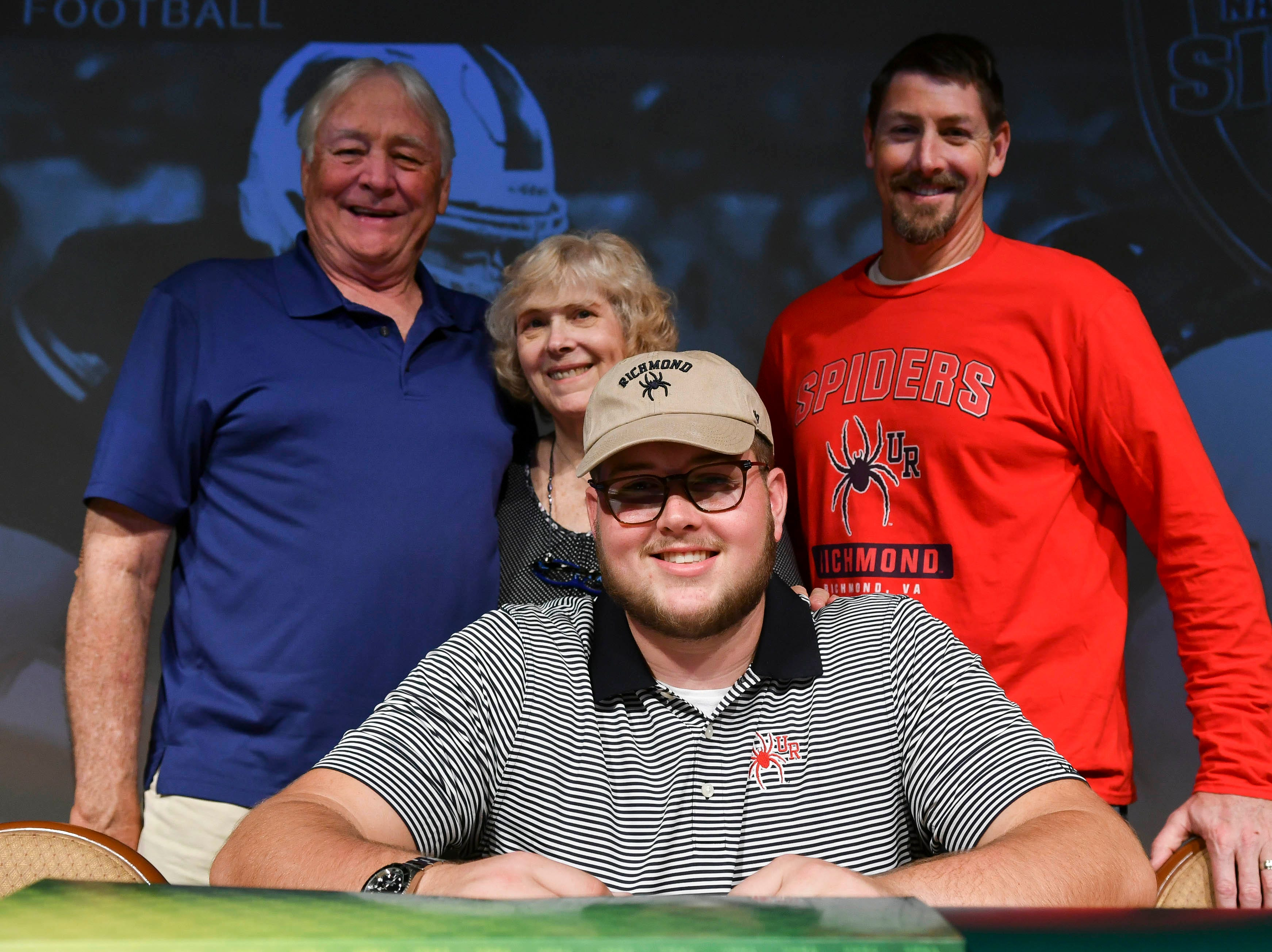 Viera High senior Gavin Lamp has his photo taken with family Wednesday during National Signing Day at the school.