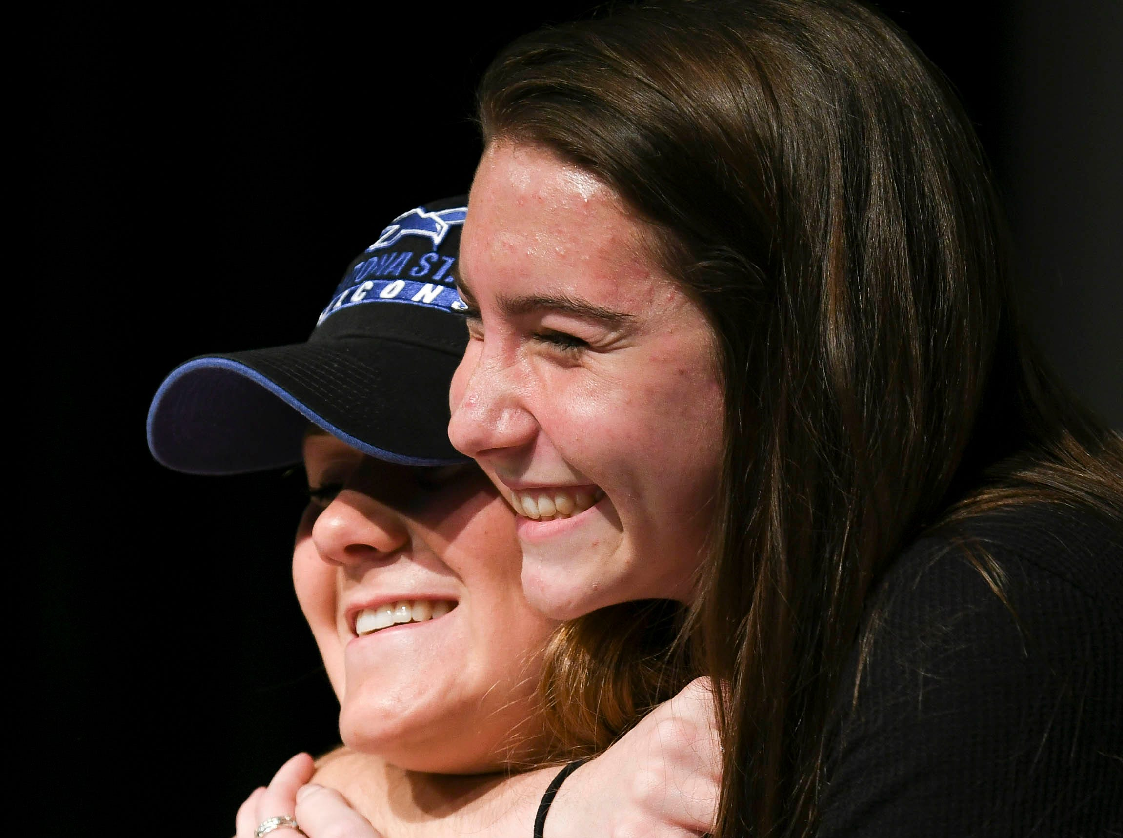 Viera High senior Cassie Bodi gets a hug after signing her letter of intent Wednesday on National Signing Day.