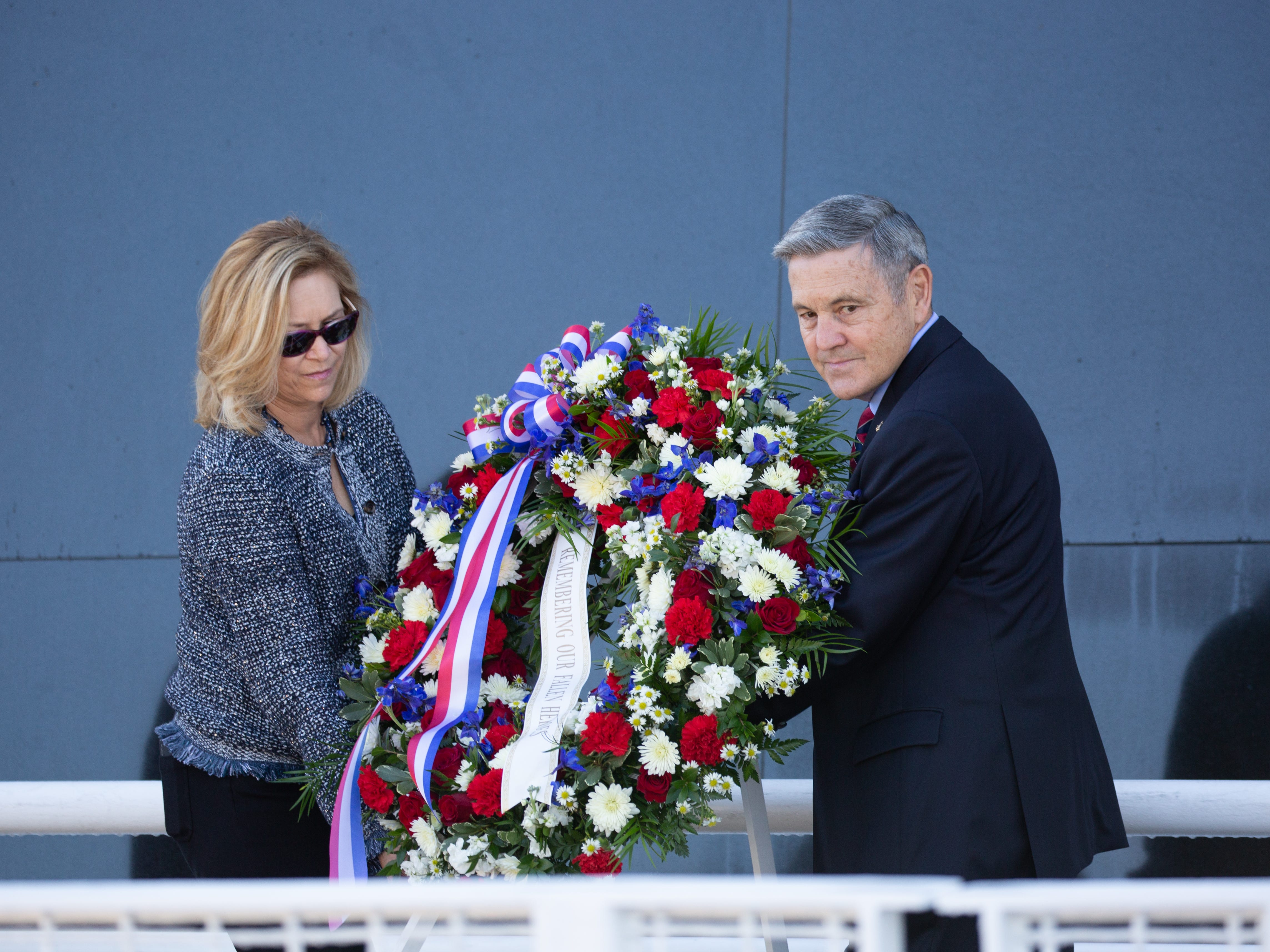 Kennedy Space Center Director Bob Cabana and Deputy Director Janet Petro move the wreath for fallen astronauts to the Space Mirror Memorial for NASA's Day of Remembrance on Thursday, Feb. 7, 2019.