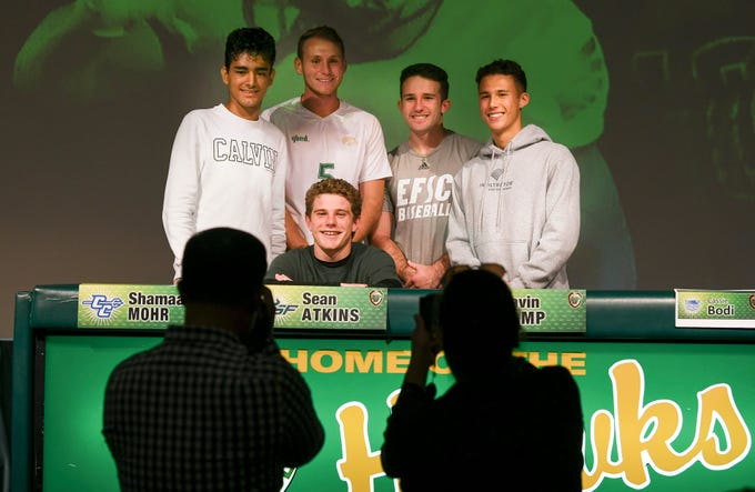 Viera High senior Sean Atkins gets his picture taken after signing his letter of intent Wednesday on National Signing Day at the school.