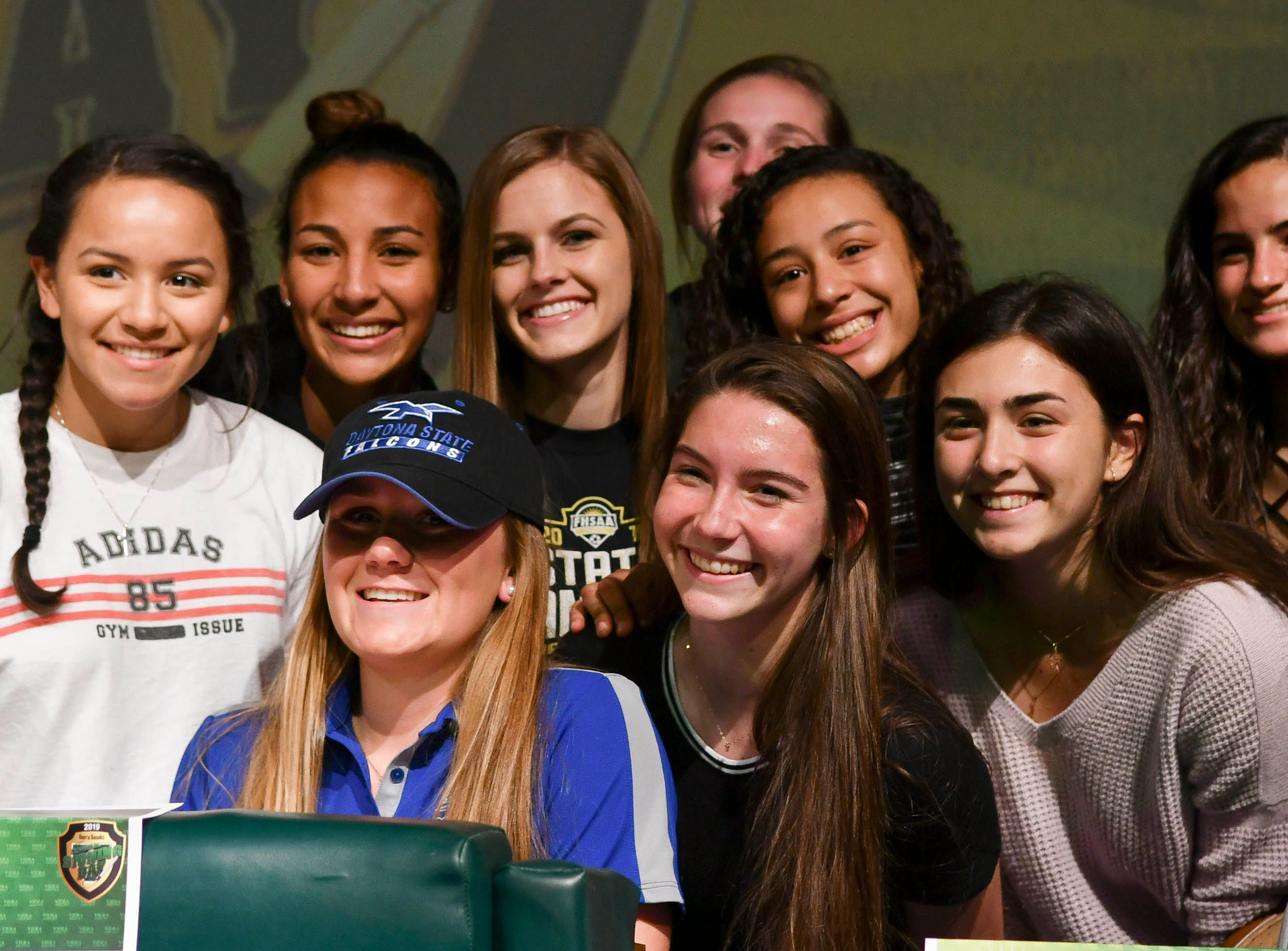 Viera High senior Cassie Bodi has her photo taken with teammates Wednesday during National Signing Day at the school. Bodi has signed to play soccer at Daytona State College.