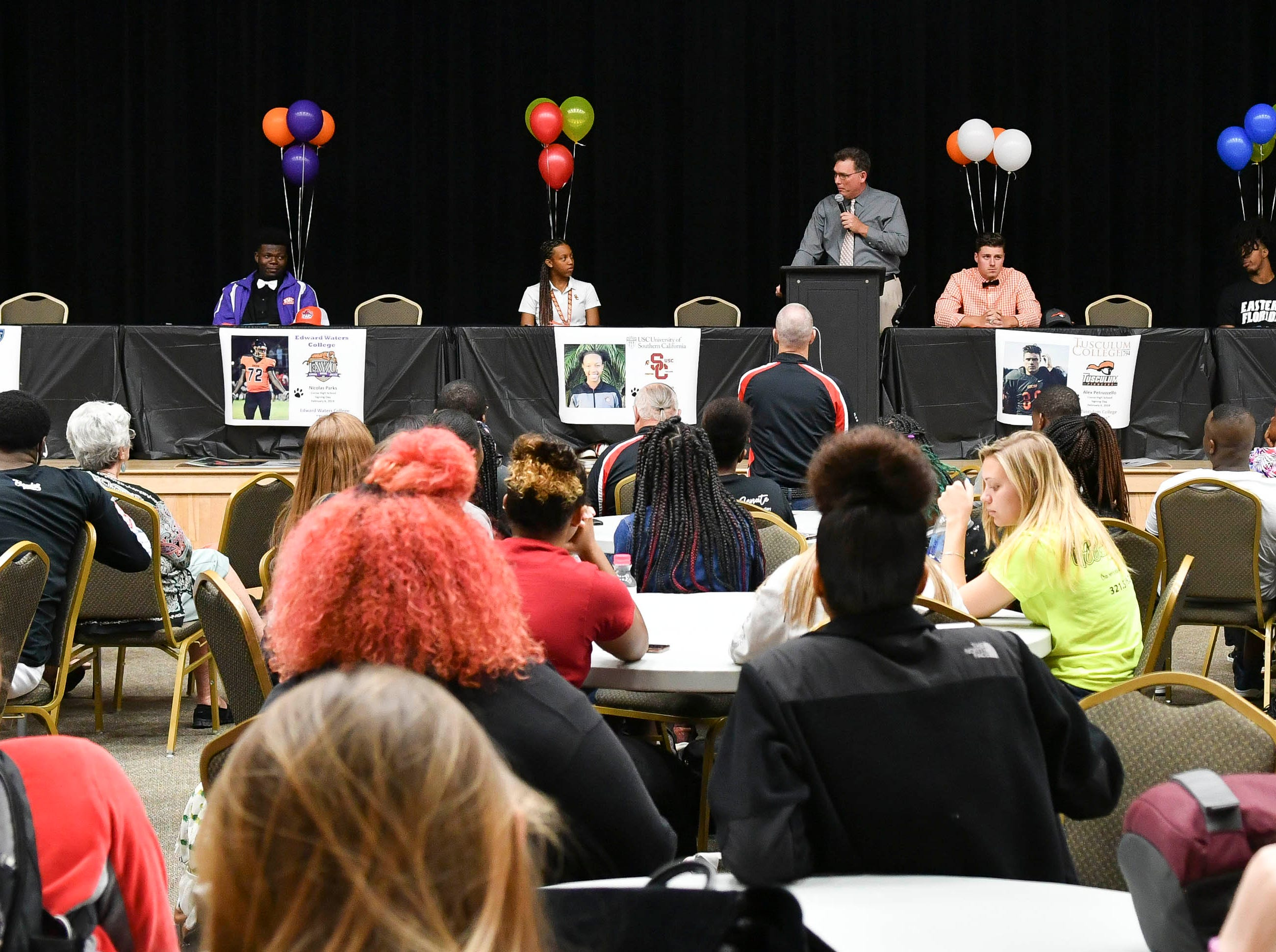 Five Cocoa High athletes signed letters of intent Wednesday during National Signing Day at Cocoa High School They are (L to R); Willie Gaines, Nicholas Parks, Jatana Folston, Nick Petruzzello and Rashean Lynn.