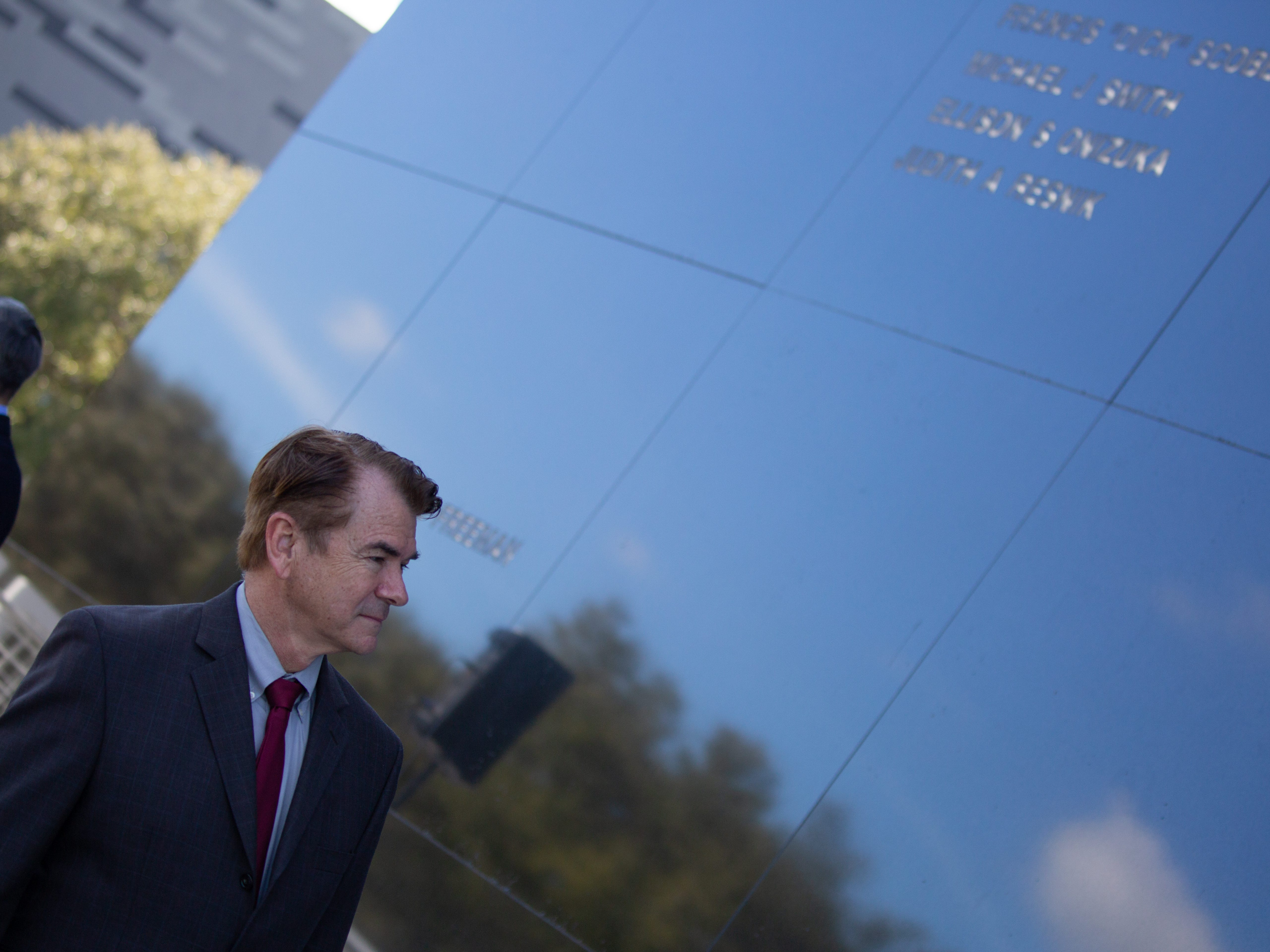 Florida House of Representatives' Thad Altman looks at the names of fallen astronauts on the Space Mirror Memorial during NASA's Day of Remembrance on Thursday, Feb. 7, 2019.
