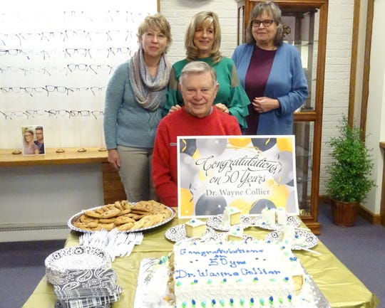 Dr. Wayne Collier, seated, celebrated his 50th year of practicing optometry in Bucyrus on Wednesday. Standing from left are Kathy Fisher, receptionist; Chris Collier; and Sheila Burg, optician.