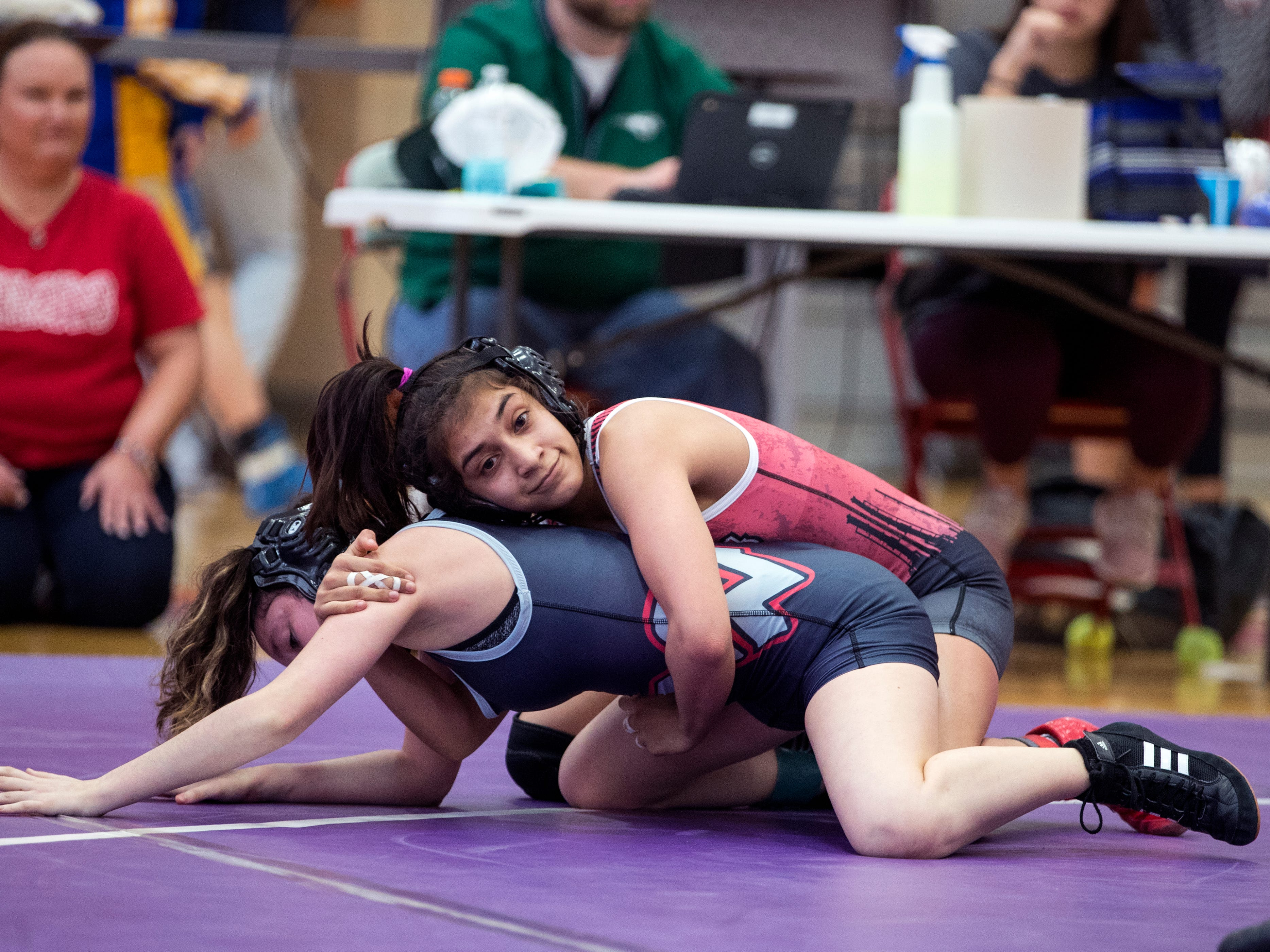 Ray's Odelia Lopez (top) and Victoria West's Rachel Supak compete in the finals of the girls 95 weight class of the District 15-5A wrestling tournament at Ray High School on Thursday, February 7, 2019.