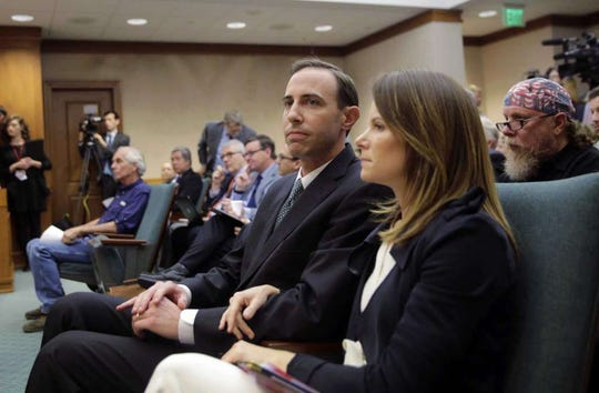 Secretary of State David Whitley, left, attends his confirmation hearing with his wife Meagan, Thursday, Feb. 7, 2019, in Austin, Texas, where he addressed the backlash surrounding Texas' efforts to find noncitizen voters on voter rolls.
