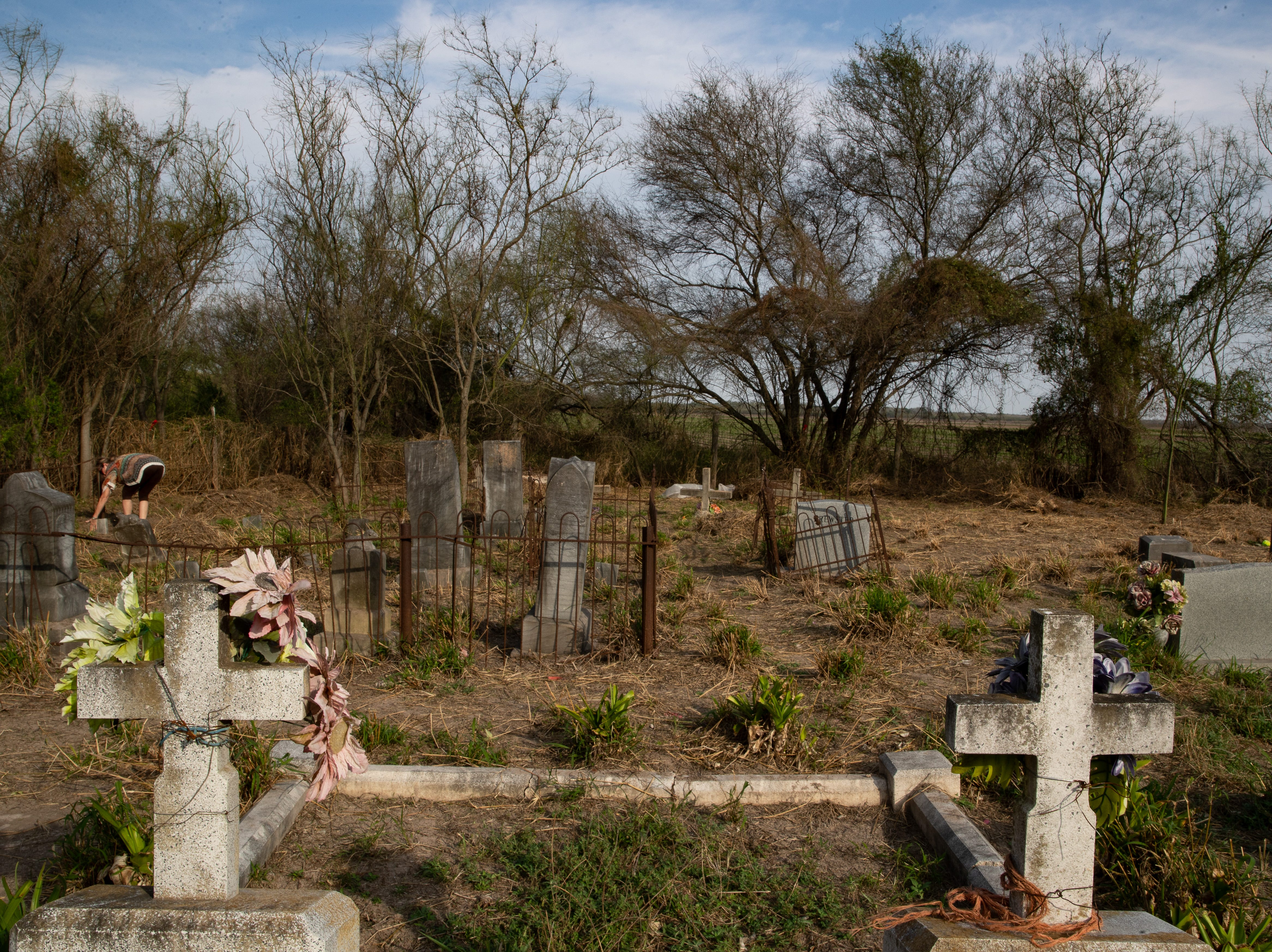 The Eli Jackson Cemetery in San Juan, Texas on Wednesday, Feb. 6, 2019. The soon-to-be-constructed border wall will be built on the levee north of the cemetery, placing the cemetery on the Mexico side of the wall. A group of people have set up a camp at the cemetery in protest of the wall's construction.