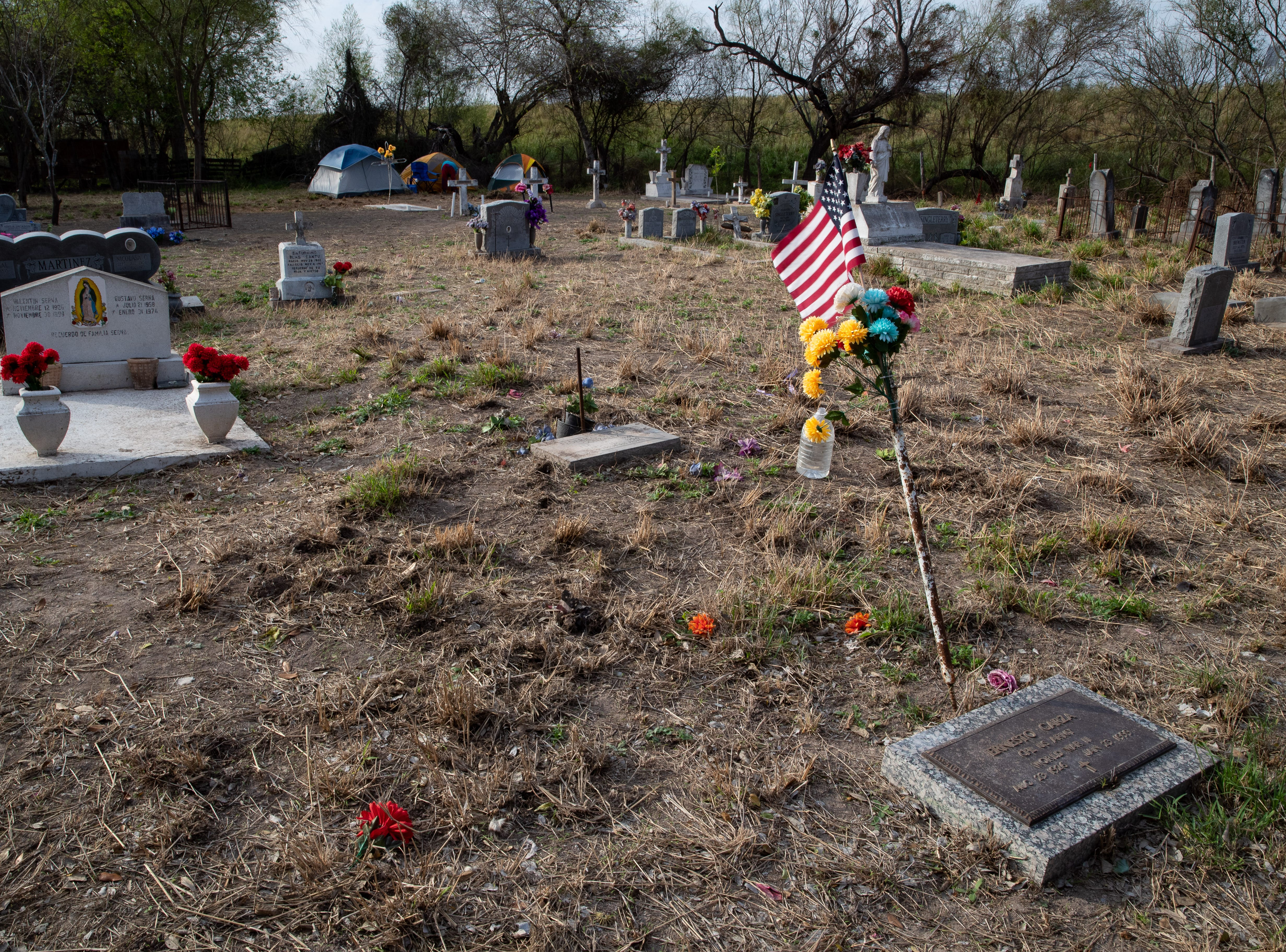 The Eli Jackson Cemetery in San Juan, Texas on Wednesday, Feb. 6, 2019. The soon-to-be-constructed border wall will be built on the levee bordering the cemetery, placing the cemetery on the Mexico side of the wall. A group of people have set up a camp at the cemetery in protest of the wall construction.