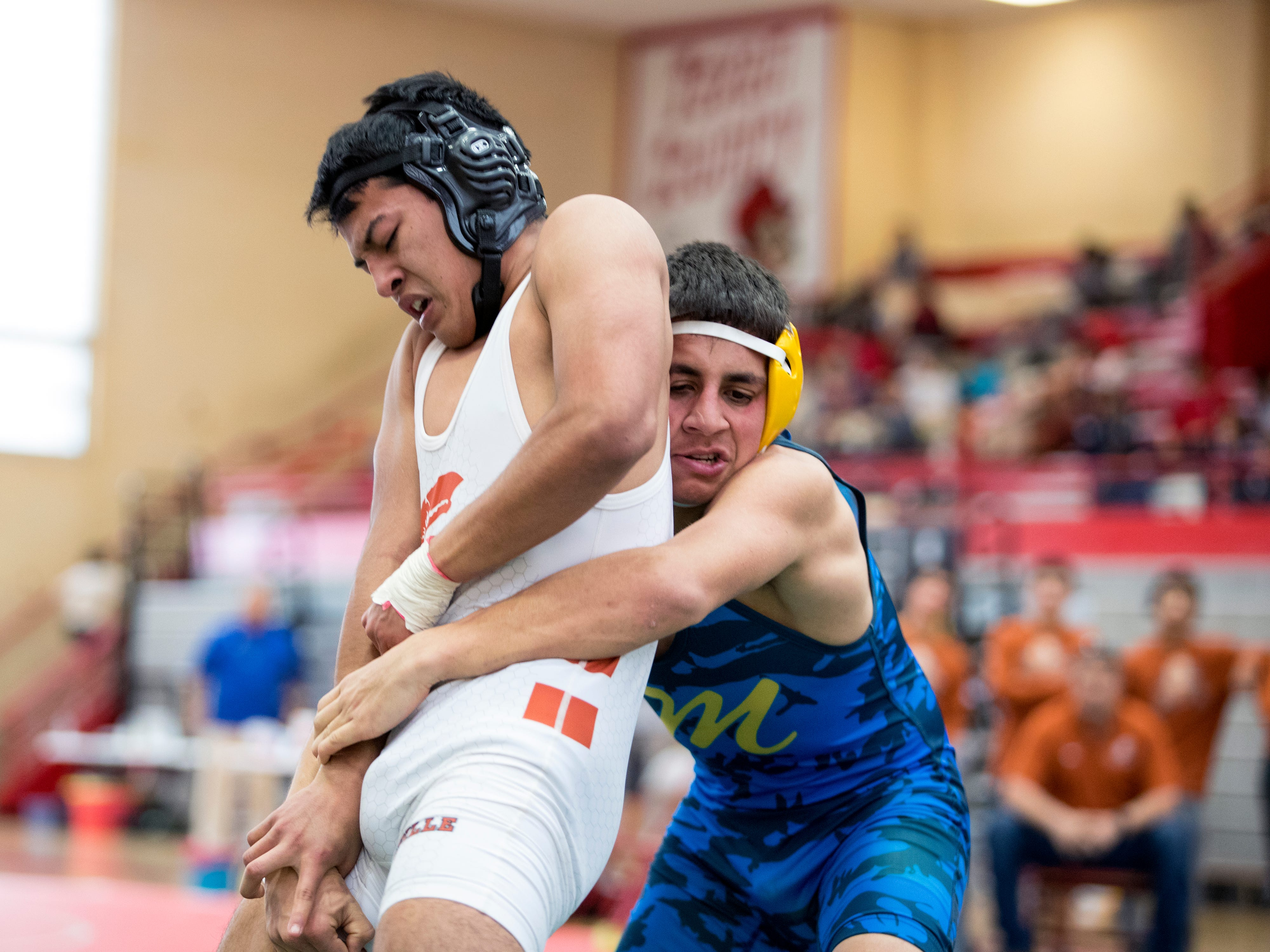 Beeville's Matthew Cardona (left) and Moody's Johnathan Shelton compete in the boys 138 weight class of the District 15-5A wrestling tournament at Ray High School on Thursday, February 7, 2019.