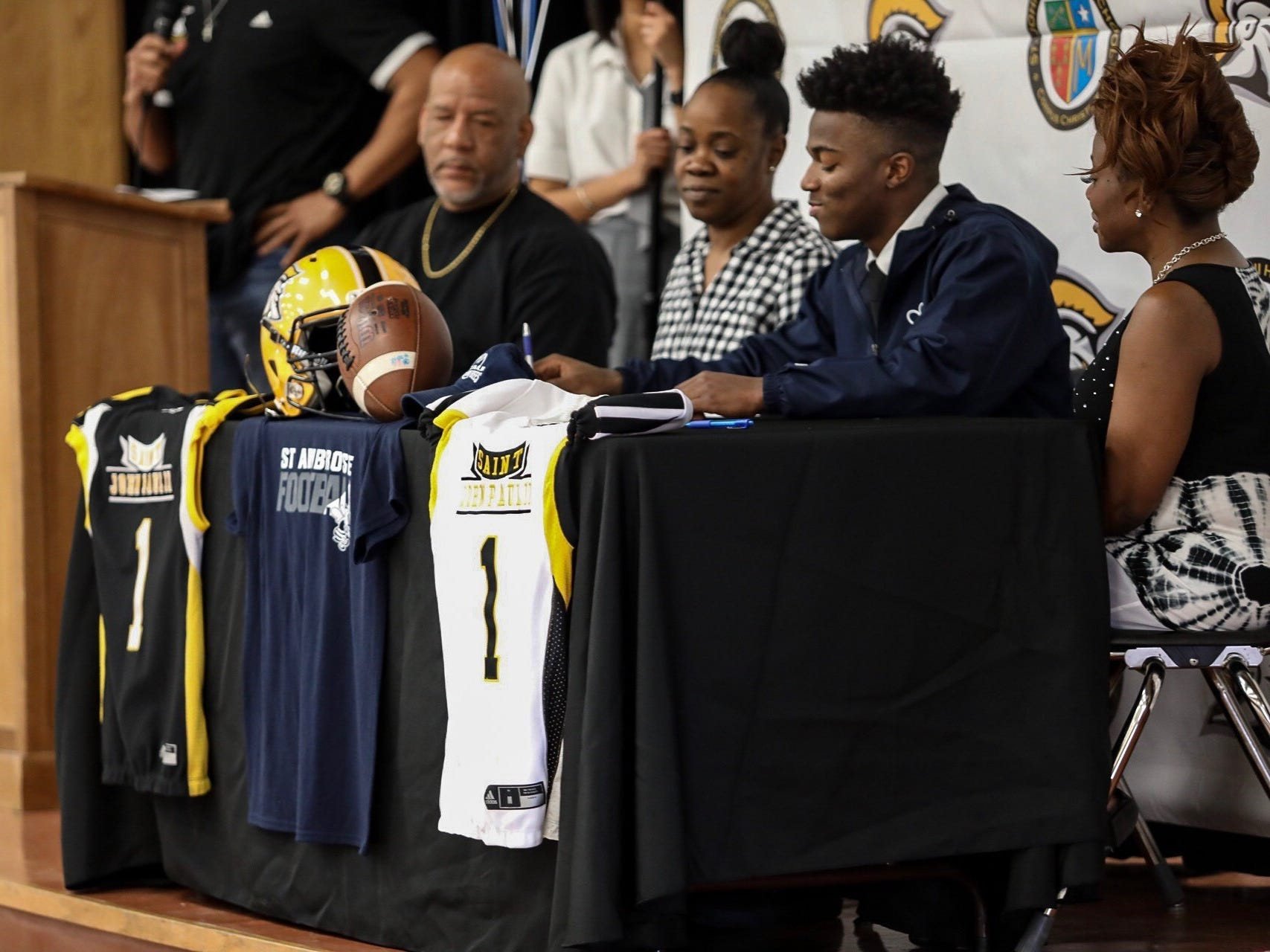 John Paul II football player Keion Lewis signed with St. Ambrose University in Davenport, Iowa and will receive a full academic and athletic scholarship.
