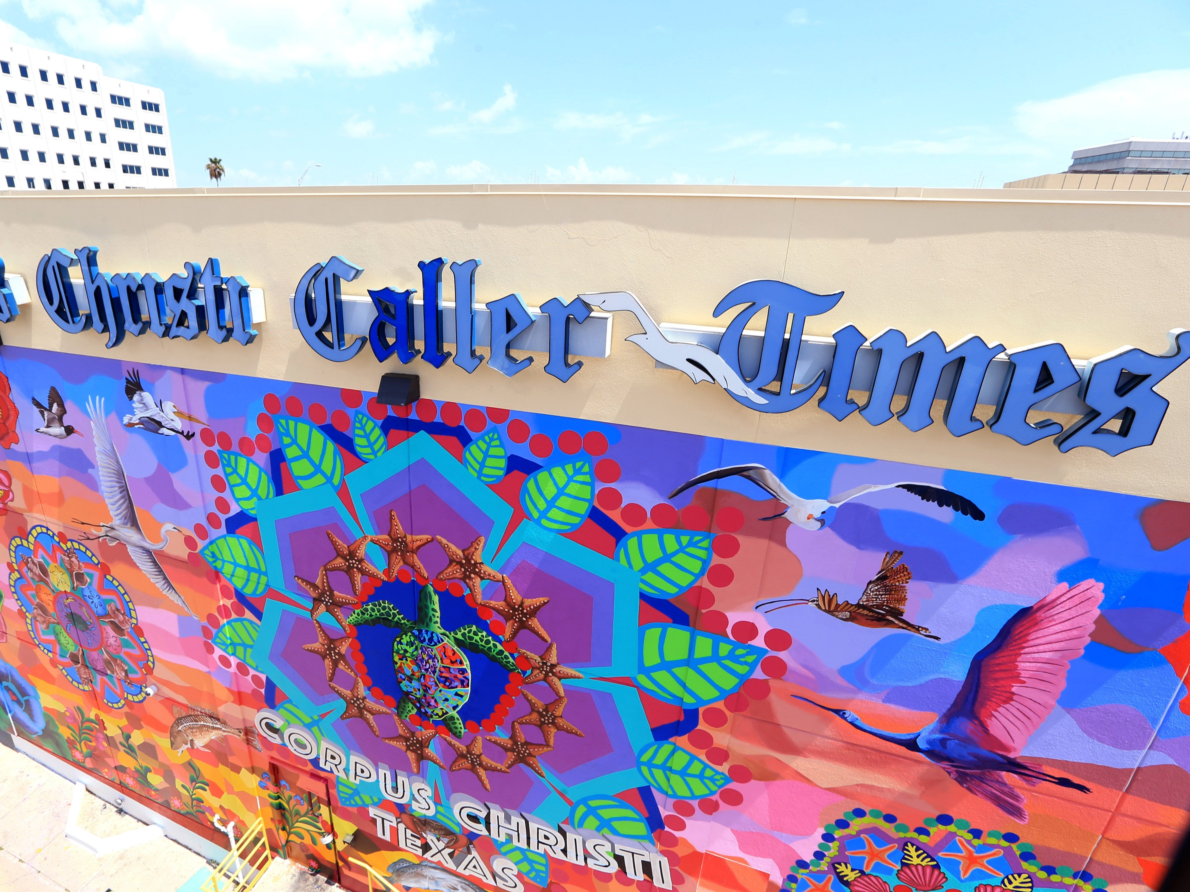 "This photograph taken July 1, 2016 shows the Caller Times' mural ""Endless Sunset: The Colors of Our City"" as nearly complete."