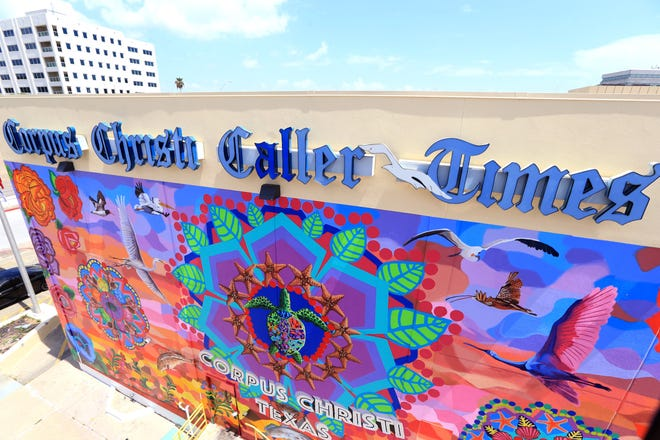 """This photograph taken July 1, 2016 shows the Caller Times' mural """"Endless Sunset: The Colors of Our City"""" as nearly complete."""