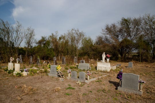 The Eli Jackson Cemetery in San Juan, Texas on Wednesday, Feb. 6, 2019. The soon-to-be-constructed border wall will be built on the levee bordering the cemetery, placing the cemetery on the Mexico side of the wall. A group of people have set up a camp at the cemetery in protest of the wall's construction.
