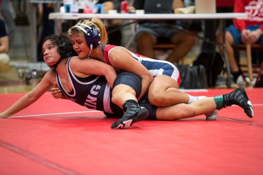 Veterans Memorial's Jacqueline Ghent (top) and King's Carissa Pena compete in the finals of the girls 110 weight class of the District 15-5A wrestling tournament at Ray High School on Thursday, February 7, 2019.