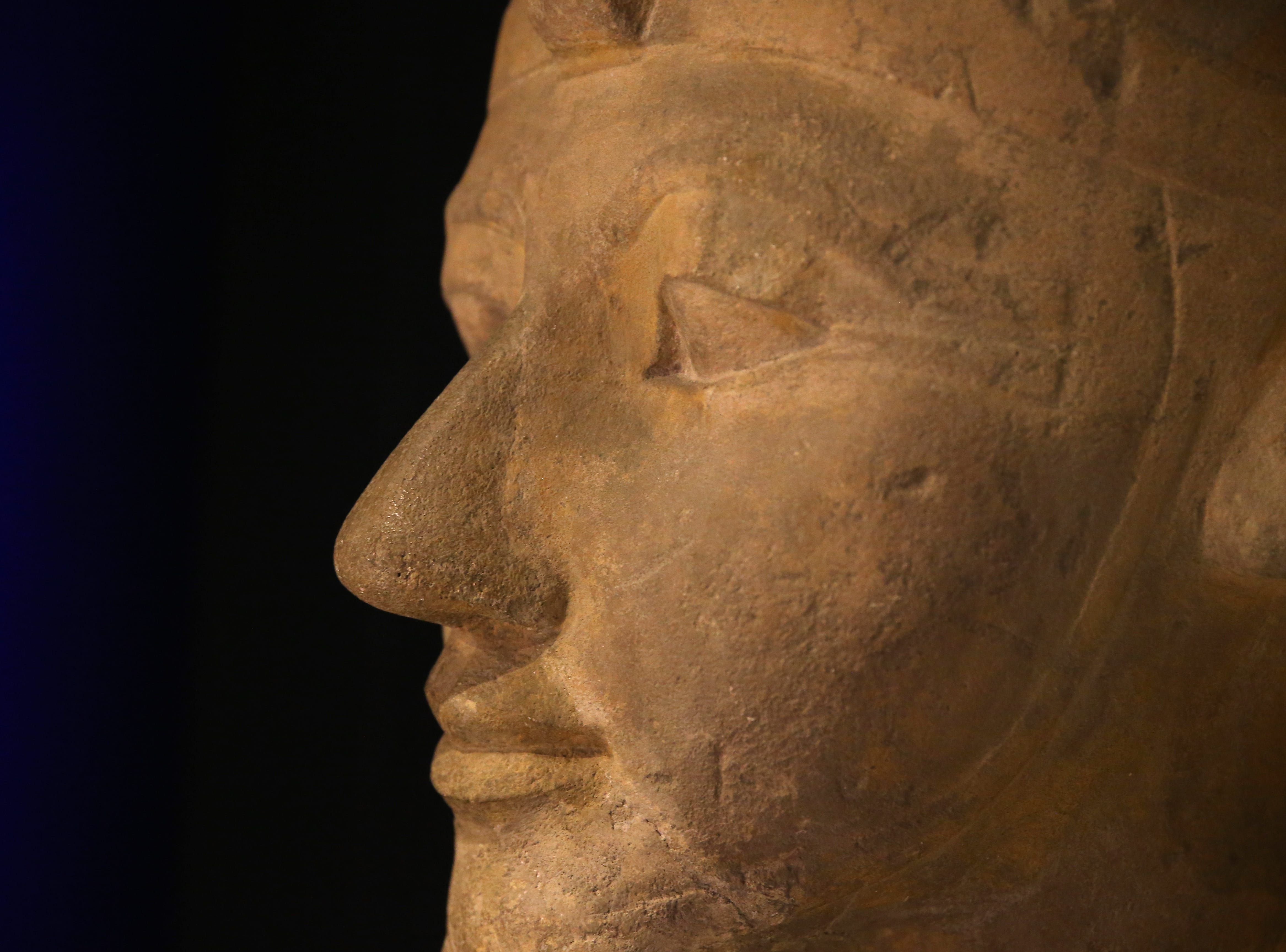 The sphinx head bust of the Pharaoh Hatshepsut, EgyptÕs longest-ruling woman, on loan from the Berlin Egyptian Museum, is uncrated for display, Thursday, Feb. 7, 2019, at Cincinnati Museum Center in Cincinnati.