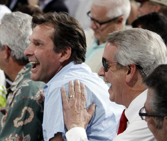 Dr. Kendall Hansen (left) reacts in 2012 at the Kentucky Derby after his horse is placed in the No. 14 post position.