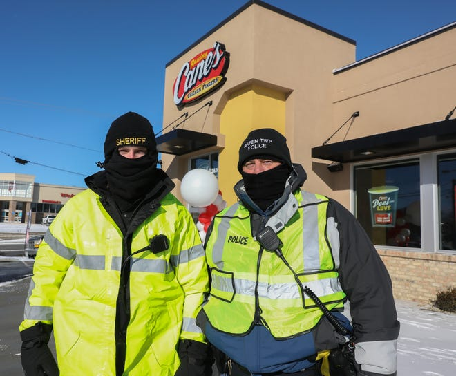 Local officers in front of Cane's.