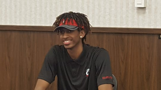 UC football commit Bryant Johnson III on signing day at Vandalia Butler