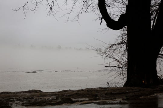 High water of the Ohio River backs up into the lower parking lot at Schmidt Park in the East End neighborhood of Cincinnati on Thursday, Feb. 7, 2019.