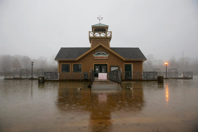Winton Lake overflows Its banks at the Winton Woods boat house Wednesday morning.