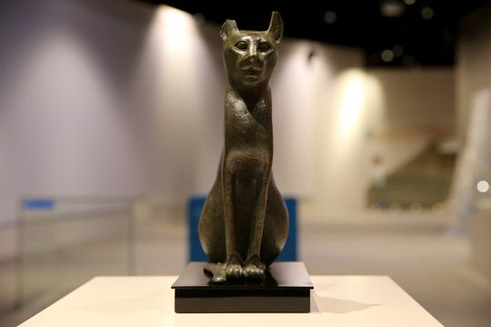 A bronze cat, often buried as a sacred object in tombs.