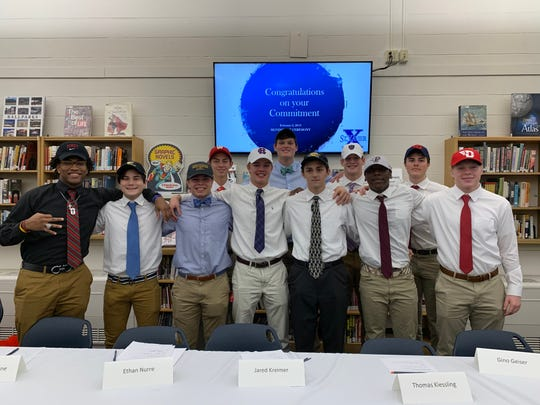 St. Xavier athletes signed their letters of intent to play college sports. They are, from left: front, Chris Payne, football, University of Indianapolis; Chris Yu, soccer, College of Wooster; Garrett Romaine, lacrosse, John Carroll University; Jared Kreimer, football, College of the Holy Cross; Gino Geiser, soccer, Northern Kentucky University; Ben (BJ) Ferguson, football, Fordham University; Nathan Arthur, football, University of Dayton; back, Michael Wampler, soccer, University of Wisconsin; Ethan Nurre, football, Dartmouth College; Thomas Kiessling, football, College of the Holy Cross; Max DeCurtins, tennis, University of Dayton.