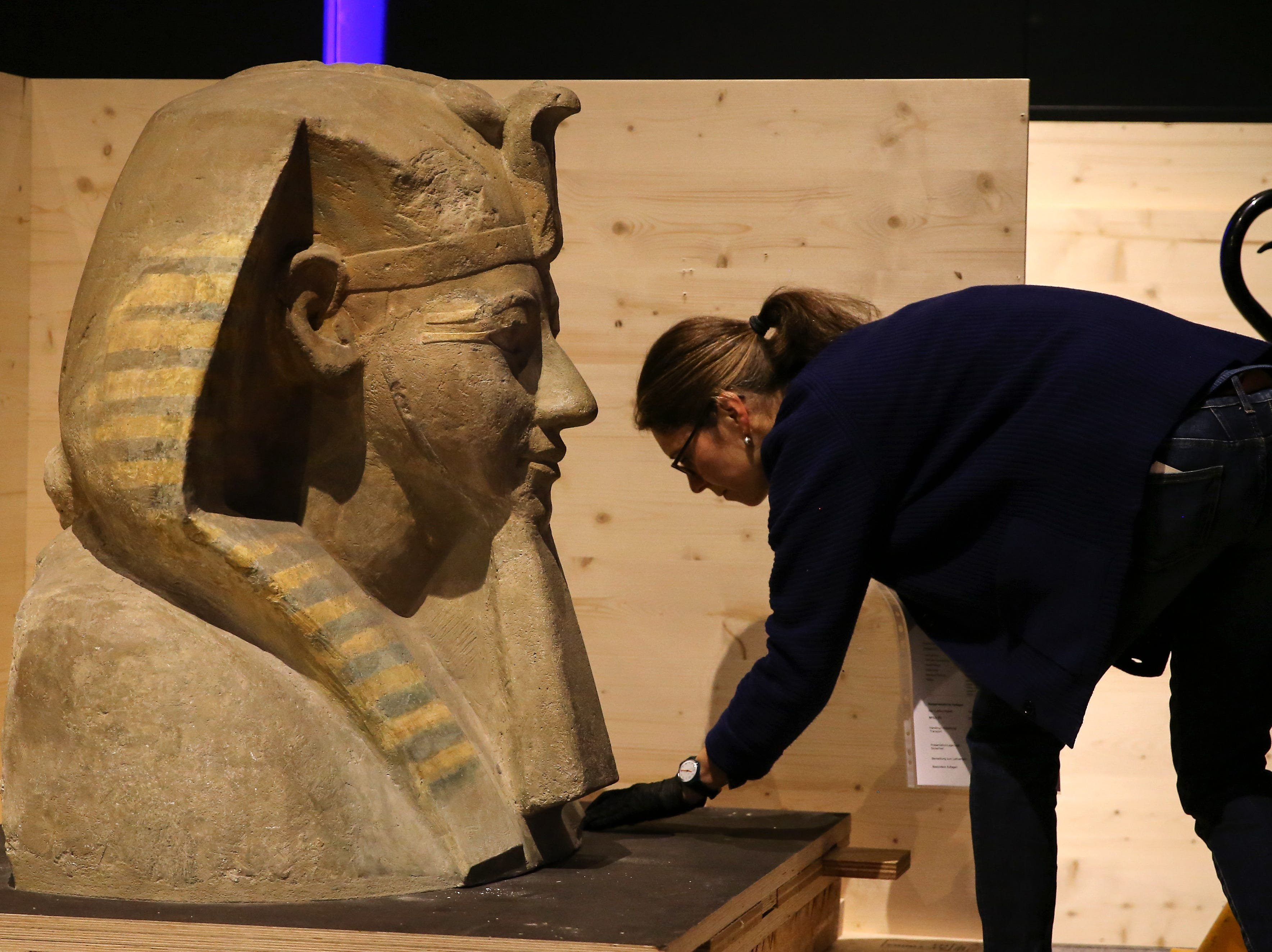 The sphinx head bust of the Pharaoh Hatshepsut, Egypt's longest-ruling woman, on loan from the Berlin Egyptian Museum, is inspected by conservator Claudia Schindler as it is uncrated for display.