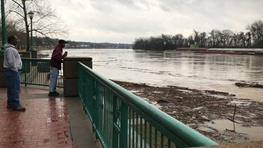 Workers at McGregor Park in Clarksville watch the rising Cumberland River and keep people off sidewalks as flood conditions worsen Thursday, Feb. 7, 2019.