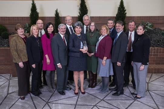 Surrounded by her Hunterdon Healthcare colleagues and pictured in the center, Geralyn Prosswimmer, M.D., FAAP, chief medical officer, Hunterdon Healthcare Partners, received the 2019 Healthcare Professional of the Year award at NJHA's 100th Annual Meeting at the Hyatt Regency Princeton.