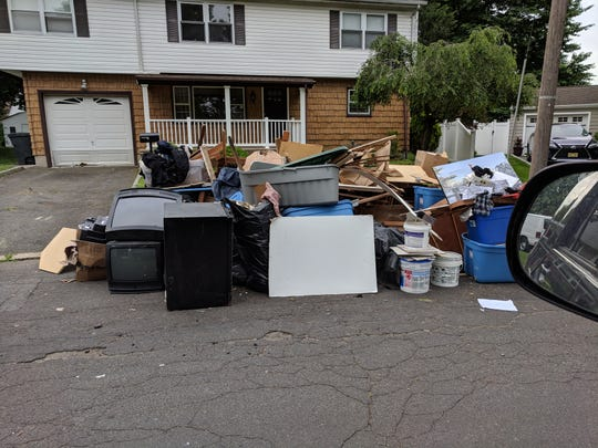 A large pile of garbage in front of Lenny Dykstra's house in Linden.