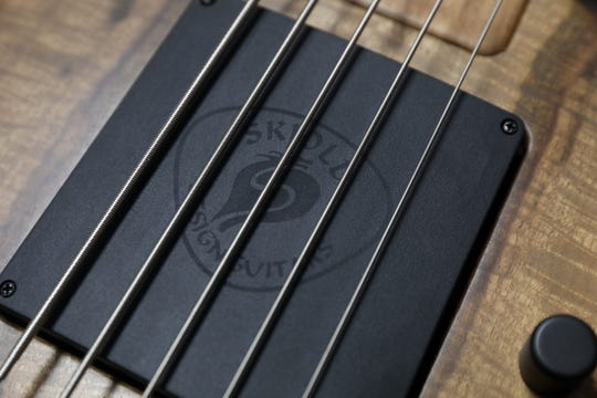The Skjold Design Guitars logo on the pickup of a bass guitar built by Pete Skjold in Warsaw.