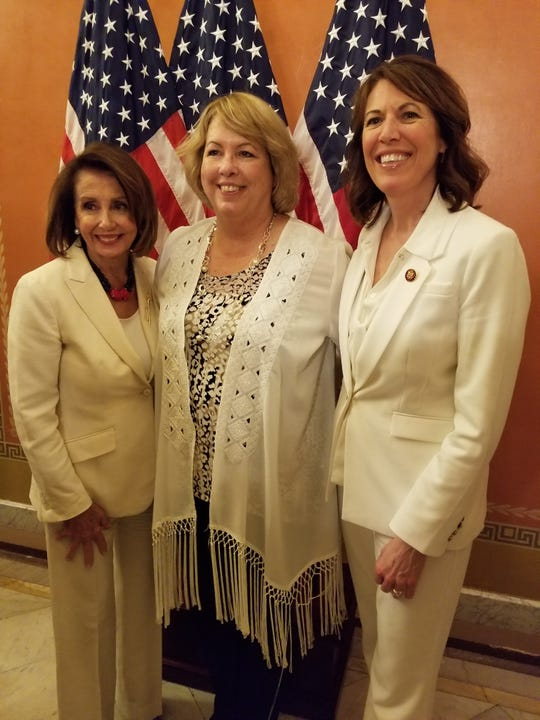 Iowan Peggy Huppert, center, poses with Speaker Nancy Pelosi, left, and Rep. Cindy Axne before the State of the Union speech.