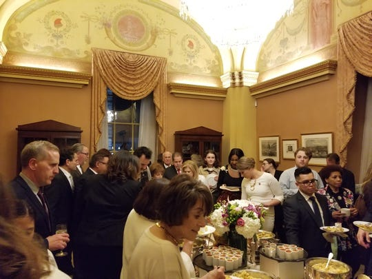 Guests enjoy a buffet during a reception at House  Speaker Nancy Pelosi's office before the State of the Union address on Feb. 5, 2019.