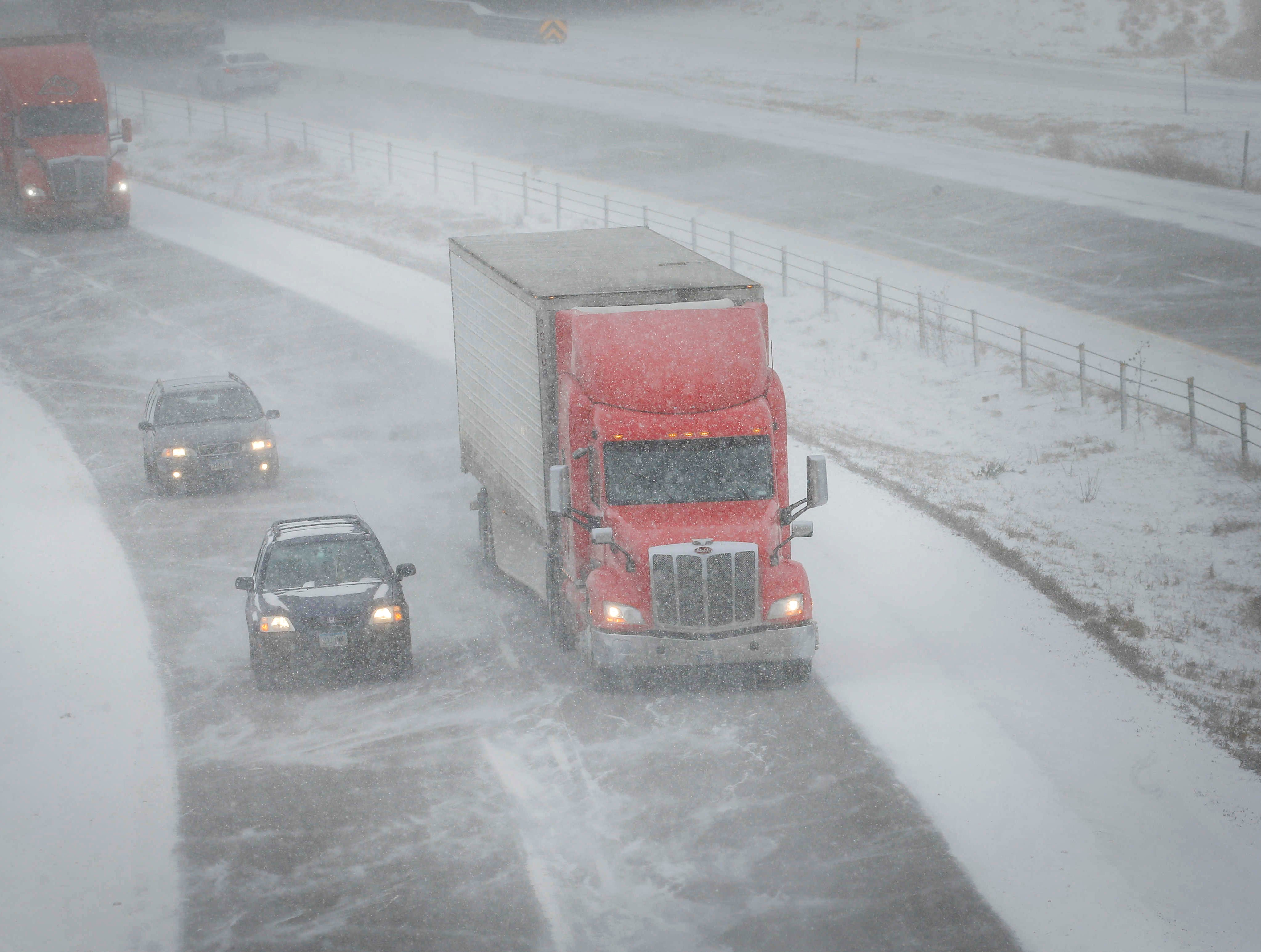 Traffic moves slowly along Interstate 80 in West Des Moines as blowing snow caused visibility issues on Thursday, Feb. 7, 2019.