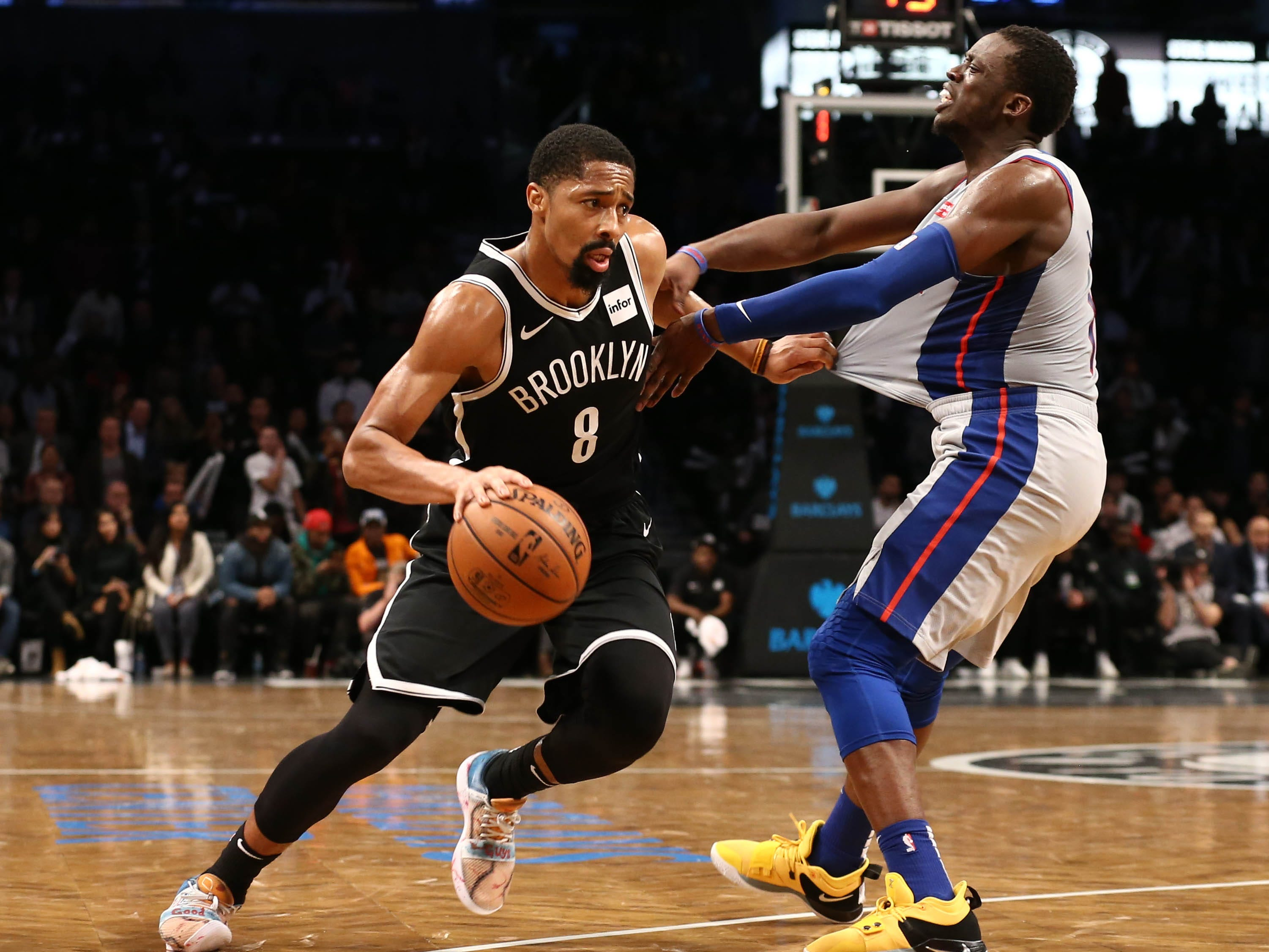 Brooklyn Nets guard Spencer Dinwiddie drives against Detroit Pistons guard Reggie Jackson in the fourth quarter Oct. 31, 2018.