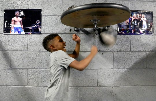 Carter Davis, 7, Detroit hits the speed bag before other kids come to practice with boxer Tony Harrison at SuperBad Fitness on Puritan Avenue in Detroit on Thursday, January, 10, 2019. Kids come to Harrison's gym four to five days a week for two hours of boxing fitness, tutoring and mentorship from Harrison and other adults.