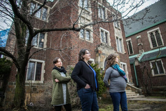 Geez magazine's associate editor Kateri Boucher, editor Lydia Wylie-Kellermann and art director Lucia Wylie-Eggert stand outside of the historic Peace and Justice Hive at St. Peter's Episcopal Church in the ever-changing Corktown neighborhood of Detroit, photographed on Thursday, Feb. 7, 2019.