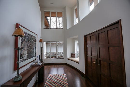 The foyer features two stories of windows and a front door made from American Cherry from the inside on this  $2,795,000 home for sale in Bloomfield Hills, Mich. on Tuesday, Feb. 5, 2019.