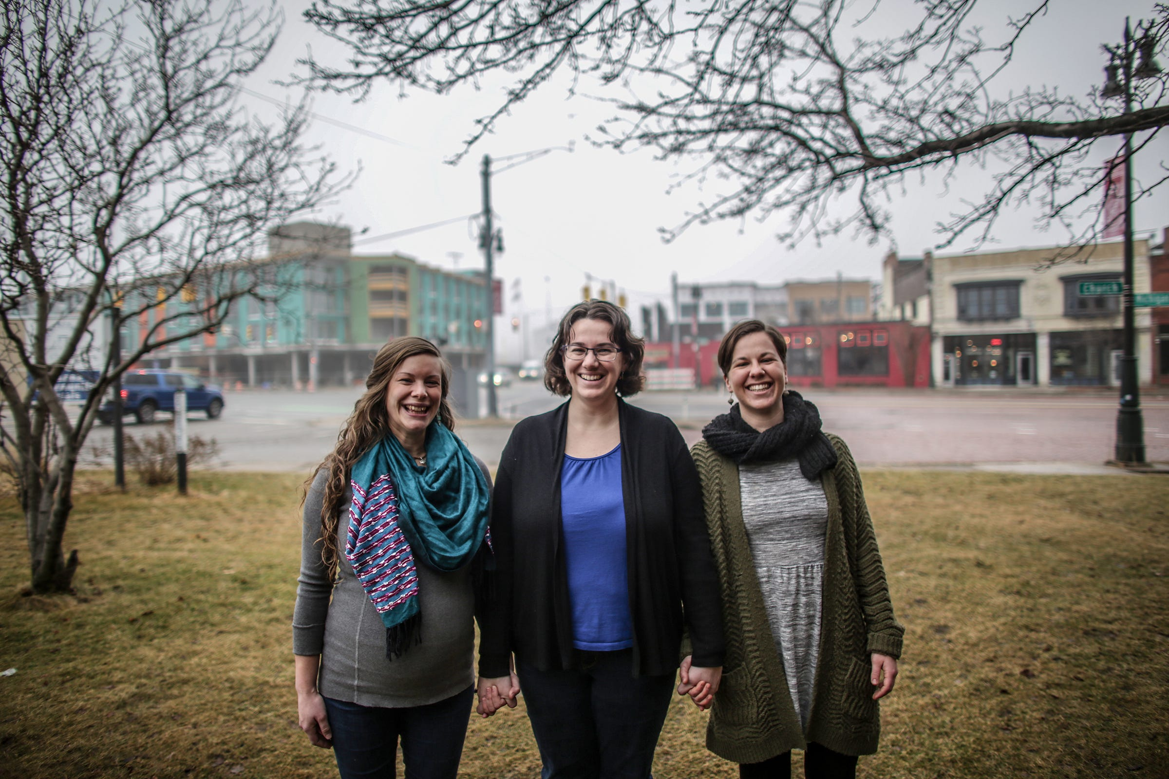 Geez magazine's art director Lucia Wylie-Eggert, Editor Lydia Wylie-Kellermann and Assoc. Editor Kateri Boucher stand outside of the Peace and Justice Hive at St. Peter's Episcopal Church on the corner of Trumbull Street and Michigan Avenue in the ever-changing Corktown neighborhood of Detroit, photographed on Thursday, Feb. 7, 2019.