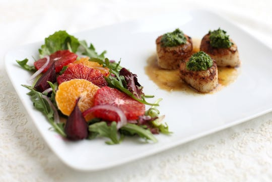 Sea Scallops on Cara Cara sauce and cilantro pesto. Clementine and Blood orange citrus salad.