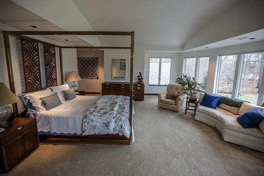 A guest bedroom features a curved ceiling that mirror curved outer wall with a private bathroom, linen closet and walk-in closet in this home for sale in Bloomfield Hills, Mich. on Tuesday, Feb. 5, 2019.