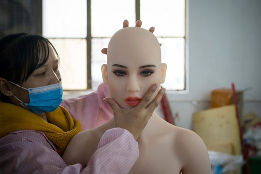A Toronto man has inquired about opening a sex doll brothel in the city of Southfield. A worker assembles a sex doll at the WMDOLL factory in Zhongshan city, south China's Guangdong province, 22 November 2018. The factory produces around 2,000 dolls a month, including dozens of different shapes of body and over 260 different faces. All dolls at the factory are handmade and each requires the cooperation of at least five workers. (Imaginechina via AP Images)