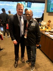 NFL Commissioner Roger Goodell with Lansing businessman  Greg Eaton in the commissioner's suite during Sunday's Super Bowl in Atlanta.