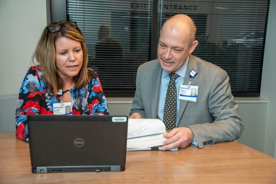Aaron Gillingham, (right), Beaumont Health's chief of human resources and Jennifer Mattucci, Beaumont human resources director of talent acquisition work on filling jobs.